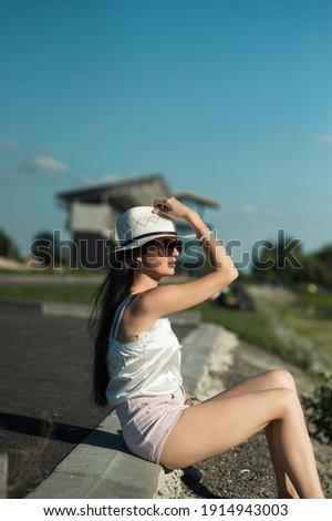 Sexy брюнетка сидят реке женщину моде Сток-фото © konradbak