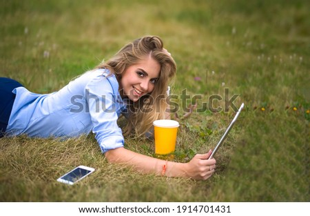 fresh young blonde using laptop outdoors stock photo © lithian