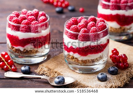 Dessert puddings with raspberries Stock photo © Alex9500