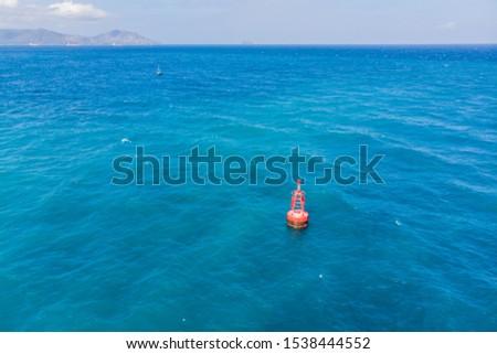 Floating red navigational buoy on blue sea, gulf. Drone Stock photo © galitskaya