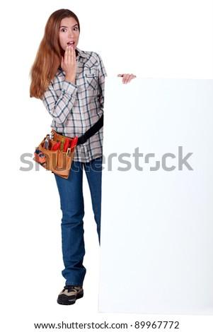 A handywoman amazed by a billboard. Stock photo © photography33