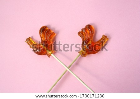 Glowing sugar cockerel on a stick Stock photo © veralub