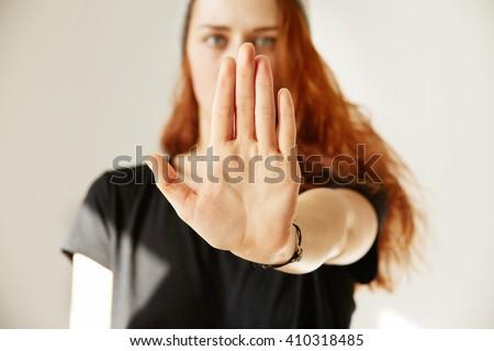 Businesswoman making stop sign against white background Stock photo © wavebreak_media