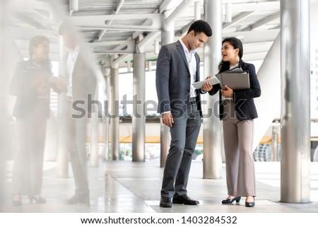 Businessmen standing on walkway Stock photo © IS2