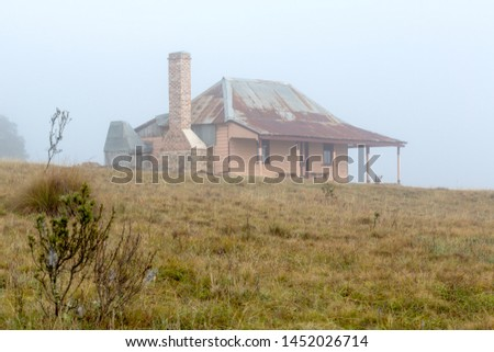 Old homestead in thick morning fog Stock photo © lovleah