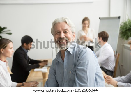 bearded businessman posing in office stock photo © pressmaster