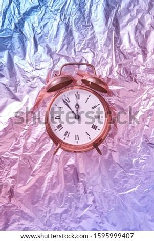New Year time on a retro cooper alarmclock. Stock photo © artjazz