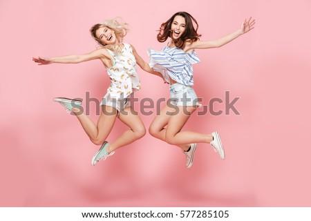 Two smiling girl friends - blond and brunette Stock photo © bartekwardziak