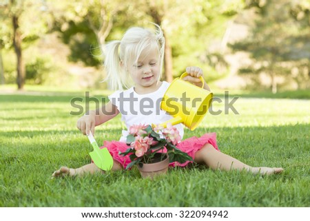 Little Girl Playing Gardener with Her Tools and Flower Pot stock photo © feverpitch