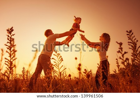 parents stand with the child on to the meadow stock photo © Paha_L