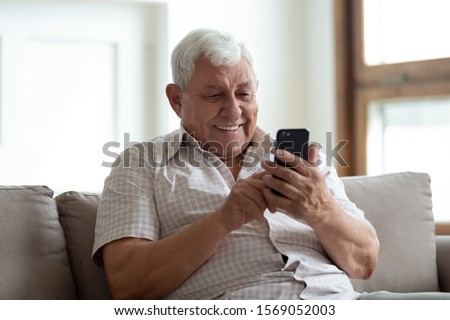 Senior Man Using Cellphone Stock photo © IS2