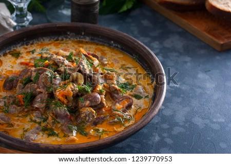 stewed chicken heart in sour cream stock photo © furmanphoto