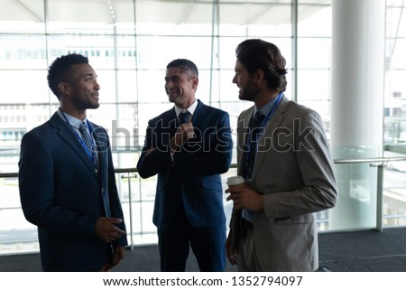Front view of three businessmen interacting with each others on first floor walkway agaisnt view on  Stock photo © wavebreak_media
