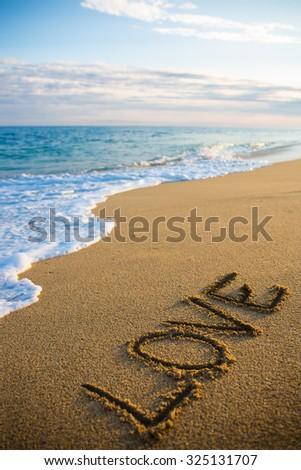 Sevmek yazılı plaj gün batımı kum romantizm Stok fotoğraf © wavebreak_media