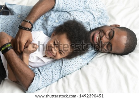 Father and Son lying on bed Stock photo © IS2