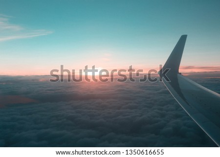 Airplane window with picture of sky cloudy aerial view. Stock photo © artjazz