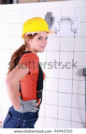 tradeswoman examining a blueprint stock photo © photography33