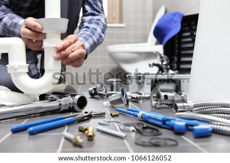 vízvezetékszerelő · tart · réz · csövek · férfi · építkezés - stock fotó © photography33