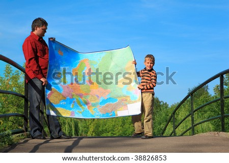 man with  boy they hold in hands  expanded map outdoor Stock photo © Paha_L
