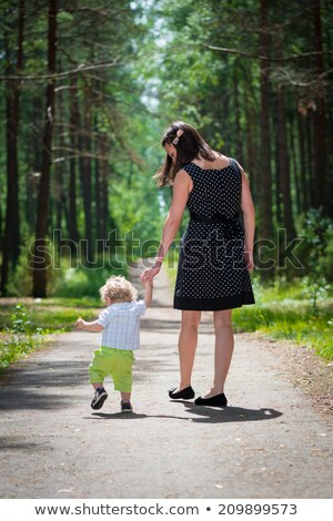 mom and son are walking on the forest road stock photo © galitskaya