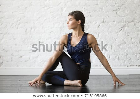 woman doing half lord of the fishes pose at home Stock photo © dolgachov