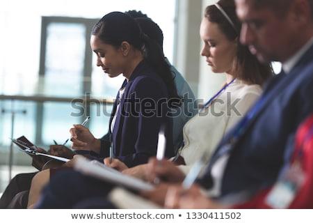 вид сбоку деловые люди Дать блокнот бизнеса Сток-фото © wavebreak_media
