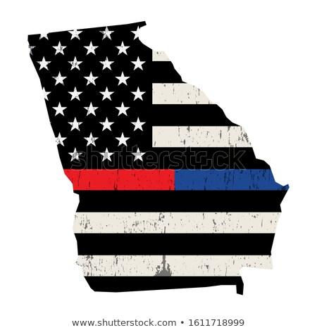 Gruzja policji strażak wsparcia banderą amerykańską flagę Zdjęcia stock © enterlinedesign