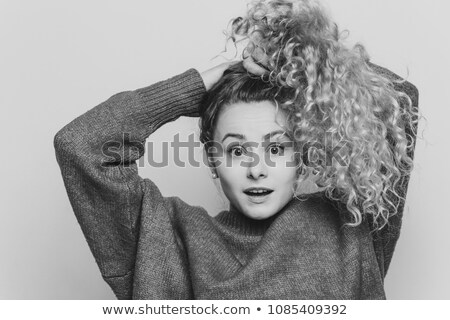 Emotional surprised female strares at camera with unexpected look, keeps hair in pony tail, expresse Stock photo © vkstudio