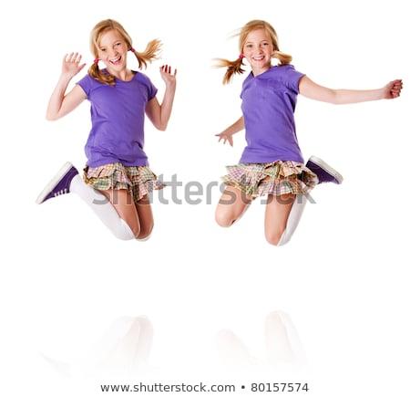 Boldog egypetéjű ikrek ugrik nevet tinédzser lányok Stock fotó © phakimata