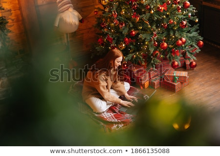 Redhead girl sitting at tree with notebook. stock photo © Massonforstock