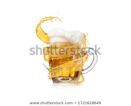 Flying spiral splash around glass of light fresh beer with thick foam. Stock photo © artjazz