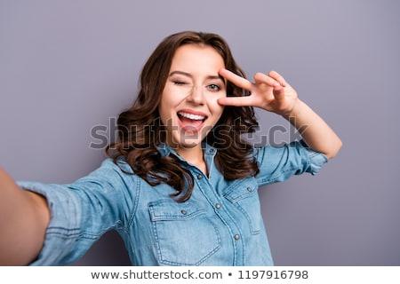 Portré fiatal vicces nő gesztikulál béke Stock fotó © deandrobot