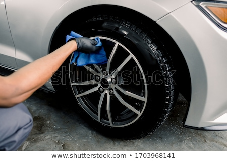 Man washing and cleaning car with spraying pressured water Stock photo © Freedomz