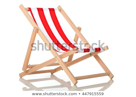 Wooden striped deck chairs stock photo © duoduo