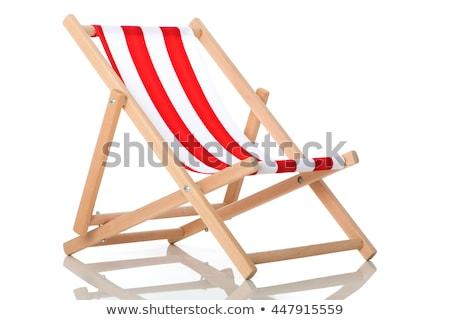 Ahşap çizgili güverte sandalye taş duvar Stok fotoğraf © duoduo