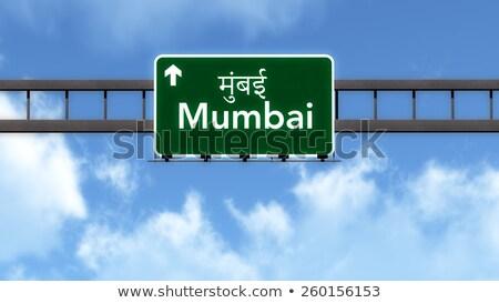 Mumbai placa sinalizadora verde sinal da estrada nuvem rua Foto stock © kbuntu