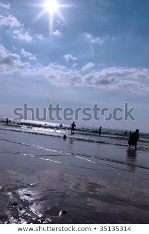 guarda-chuva · dourado · areia · praia · laranja - foto stock © morrbyte