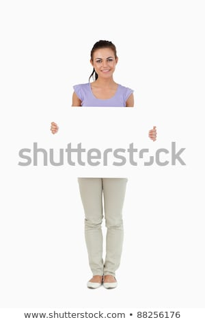 attractive young woman holding blank note card stock photo williv