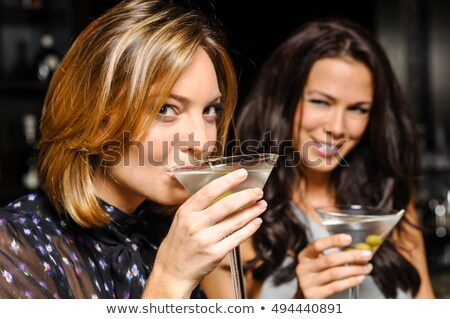 Woman sipping martini. stock photo © iofoto