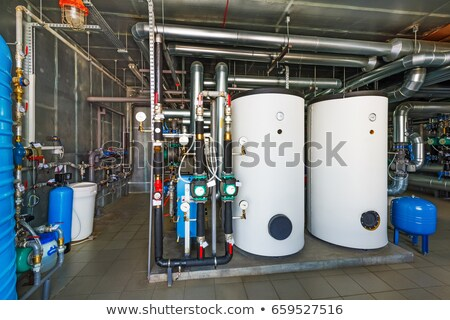 Installing pipes for hot water and steam heating Stock photo © deyangeorgiev