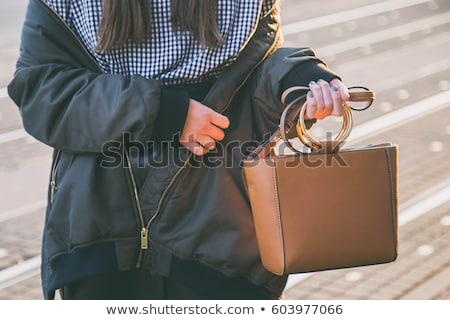 model checks her bag Stock photo © zastavkin