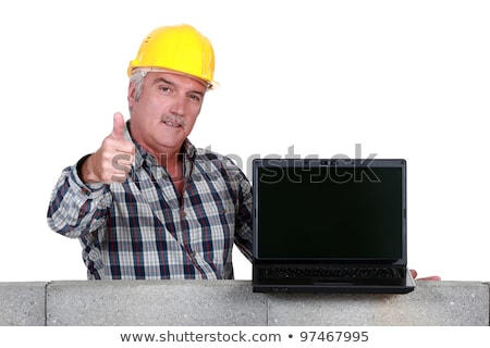 Approving tradesman embracing technology Stock photo © photography33