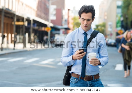 Worried man typing an sms Stock photo © photography33