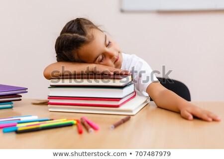 Fiatalember alszik könyvek könyv iskola oktatás Stock fotó © elly_l