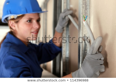 tradeswoman installing electrical wiring stock photo © photography33