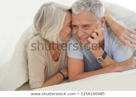 Senior relaxing in bed Stock photo © photography33