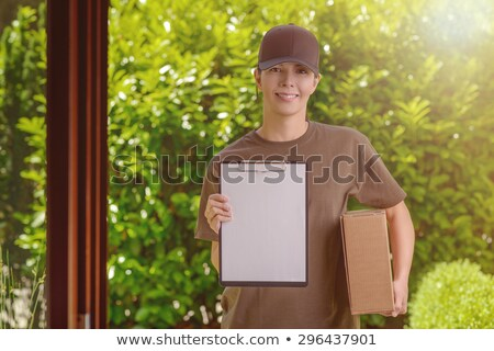 courier with parcels and clipboard stock photo © photography33