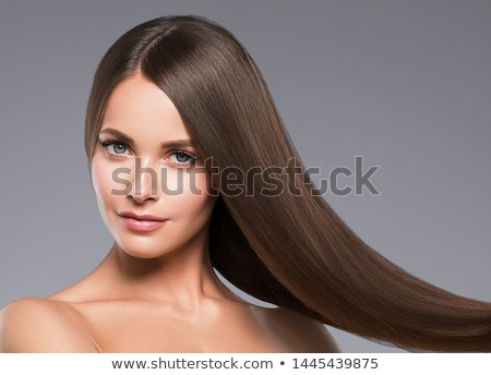 Young beautiful woman with long straight brown hair smiling Stock photo © Elmiko