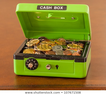 Green cash box with gold and silver coins Stock photo © backyardproductions