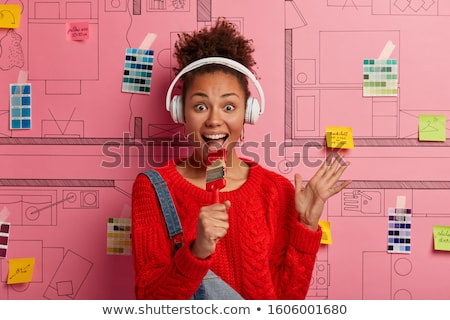 woman painting wall in red stock photo © photography33